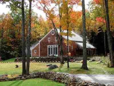 fall barn through trees